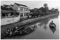 Waterfront with people selling from boats. Hoi An, Vietnam ( black and white)