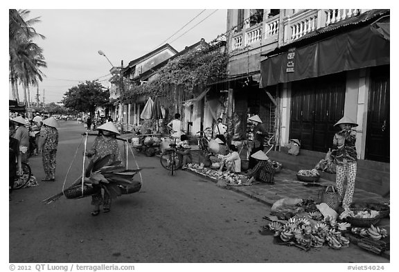 Fruit and vegetable vendors in old town. Hoi An, Vietnam (black and white)