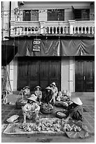 Banana vendors and historic house. Hoi An, Vietnam (black and white)