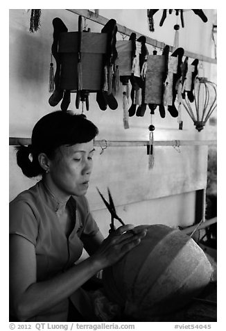 Woman working on paper lantern. Hoi An, Vietnam (black and white)