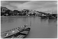 Boats, Thu Bon River, and houses. Hoi An, Vietnam ( black and white)