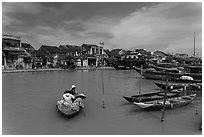 Women crossing the Thu Bon River in a rowboat. Hoi An, Vietnam ( black and white)