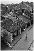 Elevated view of street with woman on bicycle. Hoi An, Vietnam (black and white)