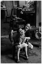 Boy and woman in kitchen. Hoi An, Vietnam (black and white)
