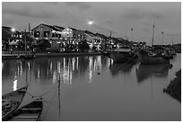 Waterfront, boats, and Thu Bon River at dusk. Hoi An, Vietnam (black and white)