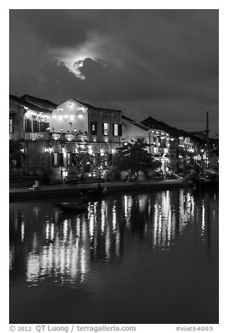 Ancient townhouses and moon reflected in river. Hoi An, Vietnam (black and white)
