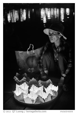 Woman selling floating candles at night. Hoi An, Vietnam (black and white)