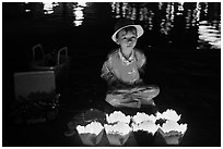 Boy selling candle lanterns at night. Hoi An, Vietnam (black and white)