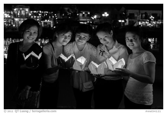 Group of women holding candles. Hoi An, Vietnam (black and white)