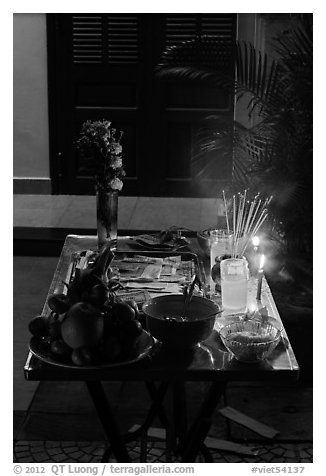 Curbside altar at night. Hoi An, Vietnam (black and white)