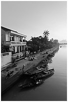 Waterfront and quay with vendors at sunrise. Hoi An, Vietnam (black and white)