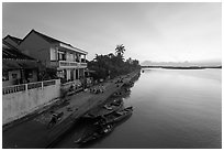 Sunrise over river and waterfront houses. Hoi An, Vietnam (black and white)