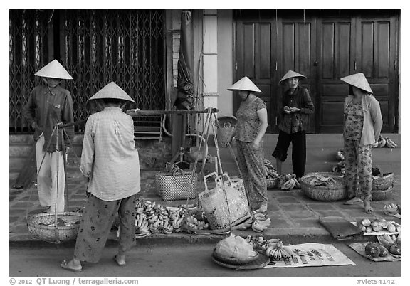 Curbside fruit vendors. Hoi An, Vietnam (black and white)