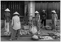 Curbside fruit vendors. Hoi An, Vietnam ( black and white)