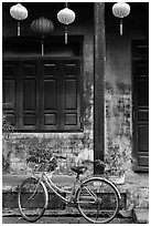 Bicycle and facade with lanterns. Hoi An, Vietnam ( black and white)