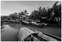 River channel and boats near Cam Kim Village. Hoi An, Vietnam ( black and white)