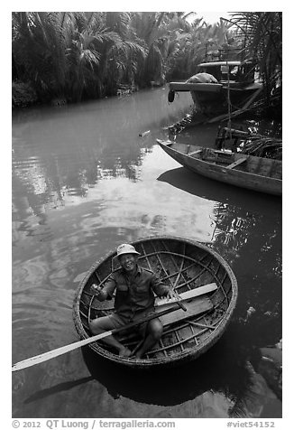 Man in circular boat near Cam Kim Village. Hoi An, Vietnam (black and white)