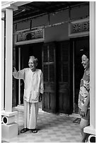 Woman and elder on porch of their house, Cam Kim Village. Hoi An, Vietnam (black and white)