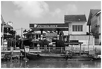 Road and river petrol station. Hoi An, Vietnam (black and white)
