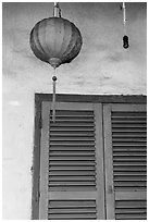 Paper lantern, wall, and blue shutters. Hoi An, Vietnam ( black and white)