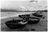 Coracle boats and city skyline. Da Nang, Vietnam (black and white)