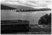 Train, bay, and village. Vietnam (black and white)