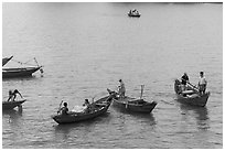 Fishermen on small boats. Vietnam (black and white)