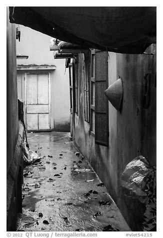 Alley and rain. Vietnam (black and white)