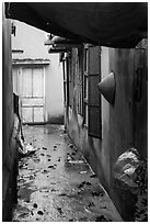 Alley and rain. Vietnam ( black and white)