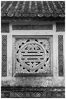 Window in the motif of Chinese symbol meaning Longevity, citadel. Hue, Vietnam (black and white)