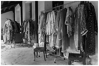 Coat hangers with silk robes in imperial style, citadel. Hue, Vietnam ( black and white)
