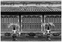 Facade with red and golden doors, imperial citadel. Hue, Vietnam (black and white)