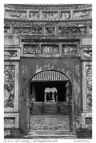 Palace and silhouettes seen from doorway, citadel. Hue, Vietnam (black and white)