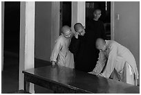 Monks looking at book, Thien Mu pagoda. Hue, Vietnam (black and white)