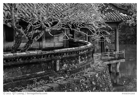 Luu Khiem Lake edge with stone fence and pavilion, Tu Duc Tomb. Hue, Vietnam (black and white)