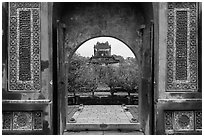 Stele Pavilion seen through the tomb gate, Tu Duc Tomb. Hue, Vietnam (black and white)