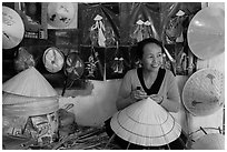 Woman in hat-making workshop. Hue, Vietnam ( black and white)
