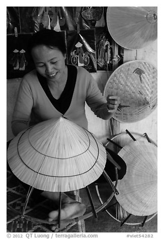 Woman crafting conical hat. Hue, Vietnam (black and white)