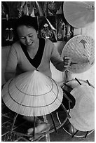 Woman crafting conical hat. Hue, Vietnam ( black and white)