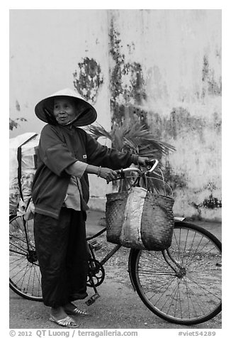 Elderly woman with bicycle, Thanh Toan. Hue, Vietnam (black and white)
