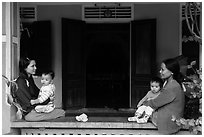 Mothers and infants on porch, Thanh Toan. Hue, Vietnam (black and white)