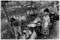 Boy waiting for donut coooked near canal, Thanh Toan. Hue, Vietnam ( black and white)