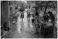 Canalside street with bicyclists and food stand, Thanh Toan. Hue, Vietnam ( black and white)