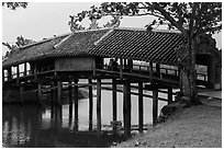 Friends sitting inside covered bridge, Thanh Toan. Hue, Vietnam ( black and white)