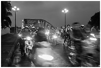 Night motorcyle traffic out of Trang Tien bridge. Hue, Vietnam (black and white)