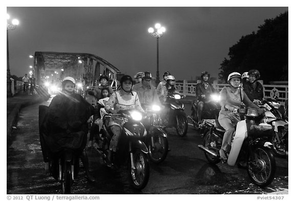 Mtorcylists by night, Trang Tien Bridge. Hue, Vietnam (black and white)