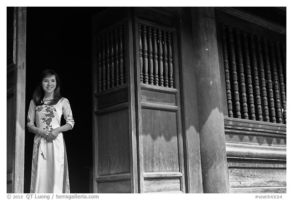 Woman in doorway, Temple of the Litterature. Hanoi, Vietnam (black and white)