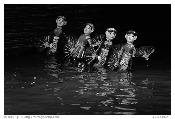 Water puppets (4 characters with fans), Thang Long Theatre. Hanoi, Vietnam (black and white)