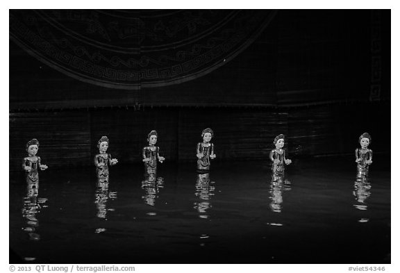 Water puppets (6 characters with lotus), Thang Long Theatre. Hanoi, Vietnam (black and white)