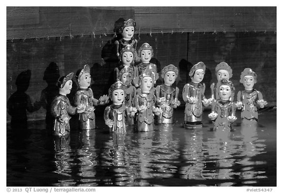 Water puppets (14 characters with lotus), Thang Long Theatre. Hanoi, Vietnam (black and white)